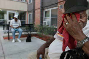 A Chicago resident struggles with triple-digit temperatures during a heat wave in 2012.