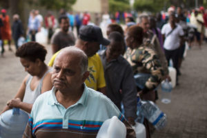 After Cape Town restricted water use in February to 13 gallons per day per person, city residents now wait in increasingly long lines to collect water from the city's natural springs.