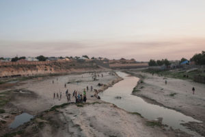 People in the northern Nigerian city of Maiduguri gather along the seasonal Ngadda River, which feeds into Lake Chad.