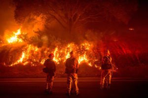 Firefighters battle a wildfire near Mariposa, California.