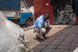 An engineer inspects paving blocks made from recycled plastics in a suburb of Accra, Ghana.