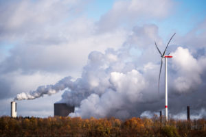 A wind turbine operating next to the Niederaussem coal-fired power plant near Bergheim, Germany.
