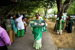 Women demonstrators protest a plan to to cut down more than 14,000 trees for a redevelopment project in New Delhi in June 2018.