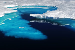 Melting ice flows into the northern Atlantic Ocean in eastern Greenland.