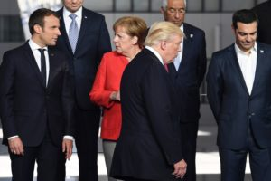 President Trump with French President Emmanuel Macron (left) and German Chancellor Angela Merkel at the NATO summit in Brussels last month.