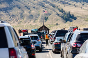 Visitors wait to enter Yellowstone National Park in June 2017.