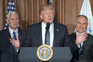 President Trump speaks at EPA headquarters prior to signing an executive order rolling back U.S. climate change commitments. He is flanked by EPA Administrator Scott Pruitt (right) and Vice President Mike Pence.