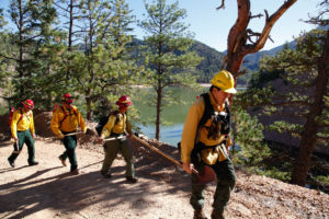 A fire crew hikes past McClure Reservoir in New Mexico en route to conducting a prescribed burn.
