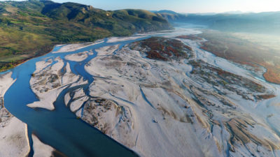 The previously undamned Vjosa River leaves vast gravel deposits along its banks in Albania as it winds its way to the Adriatic Sea.