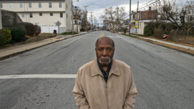 Marvin Thomas, a longtime civic activist, stands at a Southbridge intersection that has flooded repeatedly in recent years.