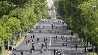 Pedestrians and bicyclists on Castellana Avenue, which was closed to vehicles, in downtown Madrid on May 10.