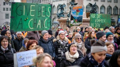 Activists gather in Munich to show support for Bavaria's biodiversity referendum in January.