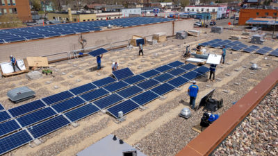 A 204-kilowatt community solar array being installed on the roof of the Shiloh Temple International Ministries in Minneapolis.