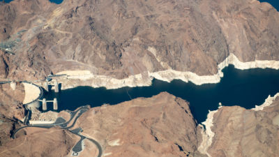 "After two decades of drought, Lake Mead, which is impounded by Hoover Dam, is just 40 percent full. A ""bathtub ring"" visible along the edges of the lake show how far its water levels have dropped."