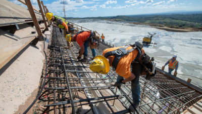 Workers repair the damaged Oroville Dam spillway in Northern California in March.