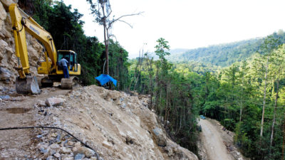 The Indonesian military clears trees for a segment of the Trans-Papua Highway in northern Papua.