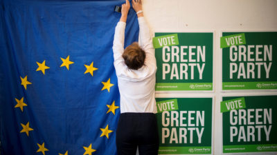 A volunteer hangs a European Union flag at a Green Party campaign office in London last month.