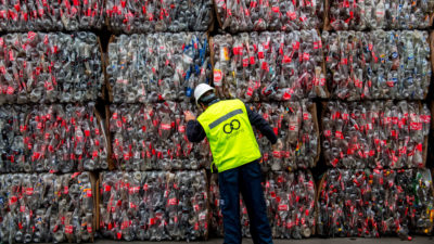 A worker examines plastic bottles at a recycling center in Santiago, Chile.