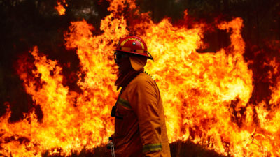 A firefighting crew works to control a blaze in Sydney, Australia in November.
