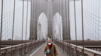 A woman walks on the Brooklyn Bridge on March 20.
