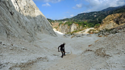 A worker collects sand at a mine near Port au Prince, Haiti in April 2014.