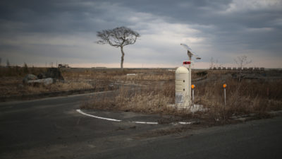 A radiation monitoring station alongside a road in Namie, Japan.