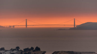 Smoke from wildfires creates an orange haze behind the Golden Gate Bridge in San Francisco.
