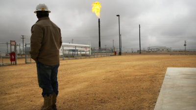 Flared natural gas is burned off at a processing plant in Garden City, Texas.