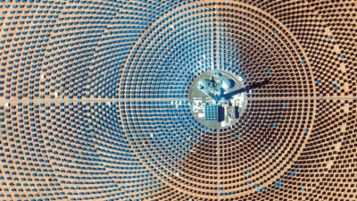 The Ouarzazate Solar Power Station, a multiphase solar power complex located in Morocco, is the world's largest concentrated solar power plant, with an energy capacity of 510 megawatts. The third phase of the facility, the 820-foot Noor III tower seen here, uses 7,400 heliostat mirrors to focus the sun's energy to heat molten salt to 500–1,022 degrees Fahrenheit, producing steam that generates electricity.