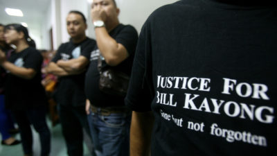 Supporters of Bill Kayong outside the court at the trial of three men charged in his murder.