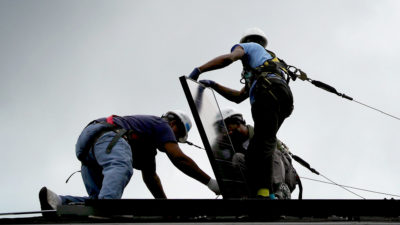 Workers in Washington, D.C. install the one millionth solar panel in the U.S. last May.