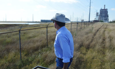 Jason Peeler looks out onto the San Miguel coal-fired power plant from his ranch in Christine, Texas.