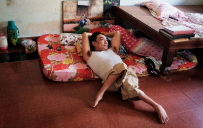 Nguyen Kien, 40, whose legs were deformed by exposure to dioxin, at his home in Trung Dung, just south of the Bien Hoa air base.