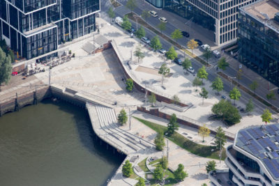 The HafenCity district of Hamburg, Germany, with a raised promenade and an elevated roadway behind it. View gallery.