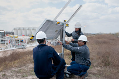 Dirk Richter (left), founder of Quanta3, inspects his company's methane detection system at a Statoil well pad in Karnes County, Texas.