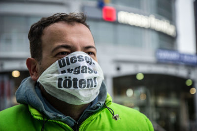 "An activist, with the phrase ""Kill Diesel Exhaust"" printed on his face mask, at a protest in Frankfurt in September 2017."