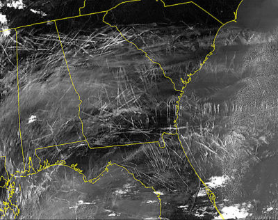 An infrared satellite image showing dozens of contrails over the southeastern United States during a single morning in January 2004.