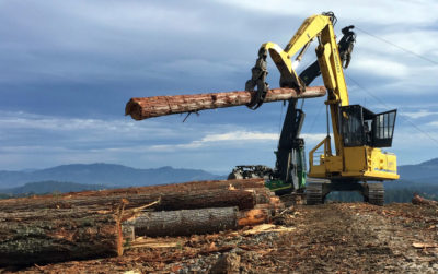 A crew in southwestern Oregon hauls logs that will be used to manufacture mass timber.