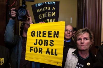 Activists protest outside Senate Majority Leader Mitch McConnell's office in Washington, D.C., in support of the Green New Deal.