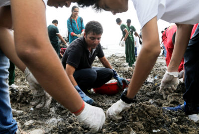 Since 2016, volunteers organized by environmentalist Afroz Shah (center) have picked up some 35 million pounds of waste — 95 percent of which has been plastic — from Versova Beach in Mumbai.