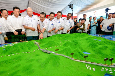 Malaysia's former Prime Minster Najib Razak, third from left, looks at a model of the China-backed East Coast Rail Link in 2017. Malaysia has since canceled the project due to mounting costs.