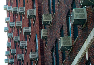 Window air conditioning units in East Harlem, New York.