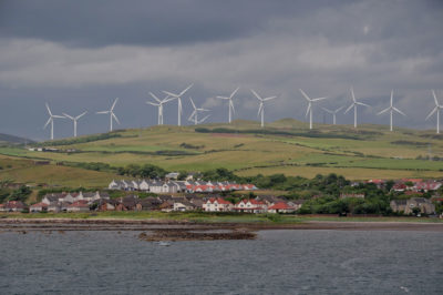 The town of Ardrossan, North Ayrshire, Scotland, surrounded by an enormous wind farm.