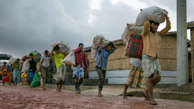 Families being relocated due to flooding and landslides in a refugee camp in Bangladesh.