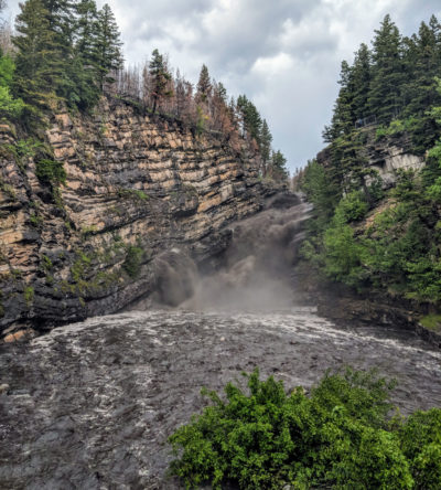 Cameron Falls runs black with soot and charred debris on June 21, one year after a fire burned through Waterton Lakes National Park in Alberta.
