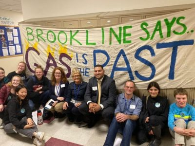 Advocates celebrate the passage of a gas ban in Brookline, Massachusetts last November.