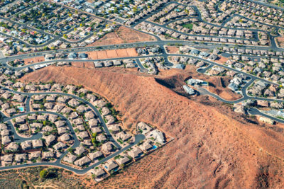 St. George, Utah has been growing rapidly, with subdivisions and golf courses pushing into the desert. Its population has grown from 20,000 to 150,000 in the last 20 years.