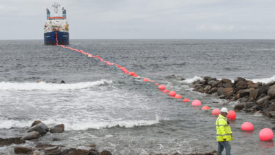 Laying electric cable at the test site of the European Marine Energy Centre in Scotland's Orkney Islands. The center allows wave-power companies to connect their devices to existing infrastructure and cabling to test their electricity-generating capabilities and identify problems with their technologies.