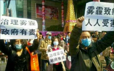 "Protestors in Beijing following the release of the viral documentary about Chinese air pollution ""Under the Dome"" in 2015."