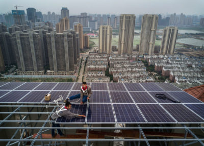 Workers install solar panels in Wuhan. China added 53 megawatts of new solar capacity in 2017.